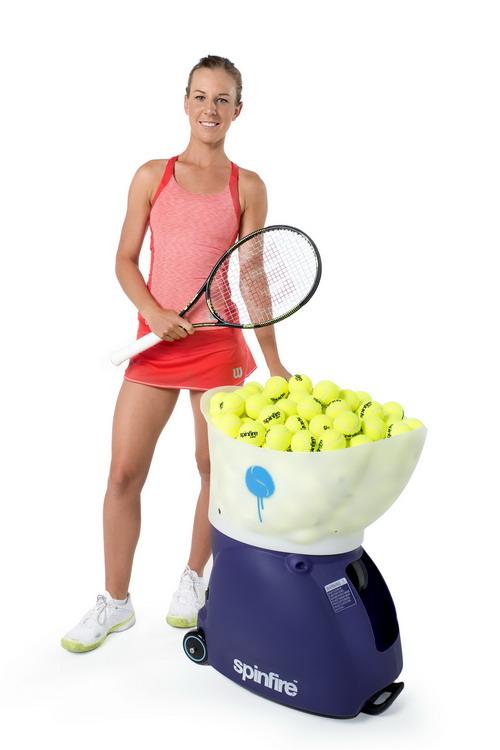 Standing Beside Spinfire Pro 2 Tennis Ball Machine